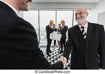 Handshake of architect and investor