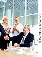 Handshake of boss