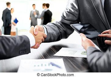 handshake of business partners after discussion of the...