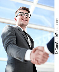handshake of business partners .bottom view - Confident...
