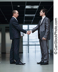 handshake of business partners in the corridor of the office