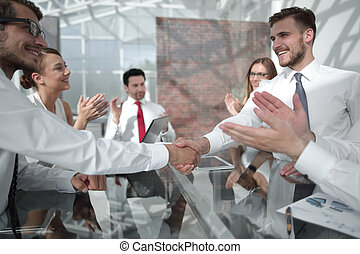 handshake of business people after the signing of the contract.