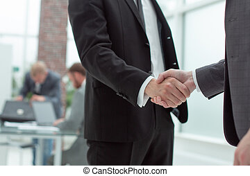 handshake of business people in a modern office