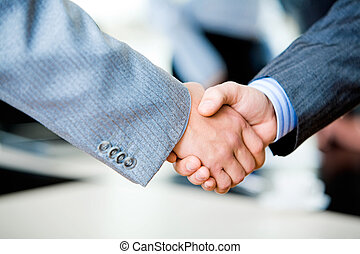 Handshake of businesspeople - Close-up of two businessmenï¿...