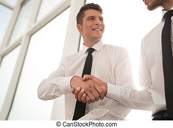 handshake of employees in the office