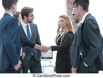 handshake of two business women in the office