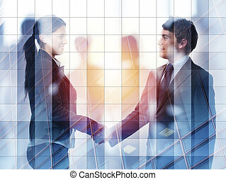 Handshake of two businessperson in office concept of partnership and teamwork.double exposure