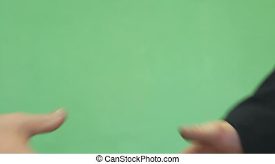 Handshake of two male students - Close-up of handshake of...