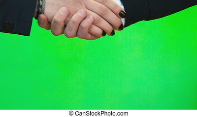 Handshake of two people. Close-up - Close-up of handshake of...