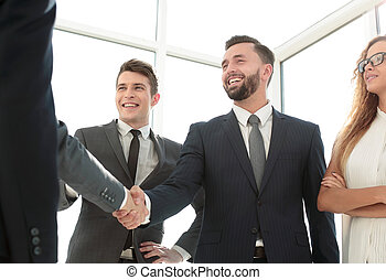 handshake of young business partners in the office