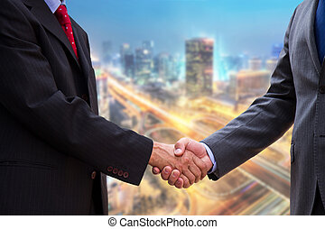 handshake on background of buildings