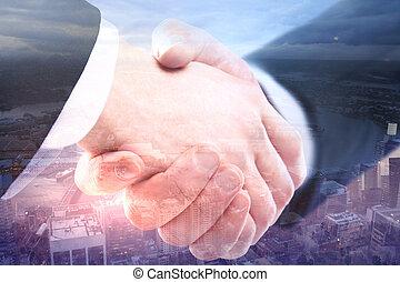 Handshake on city background