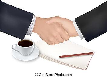 Handshake over paper and pen
