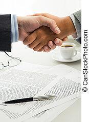 Handshake over workplace - Image of business handshake over...