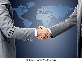 handshake over world map - handshake over world map