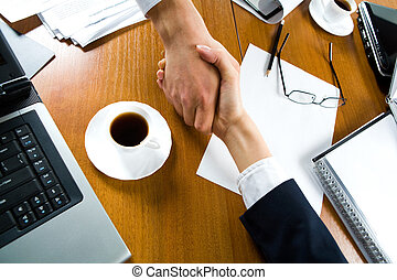 Handshake - Photo of handshake of business people over the...