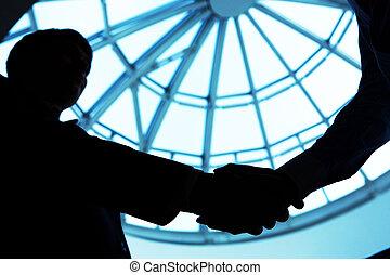 Handshake  - Outline of business handshake in the office