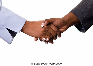 Two women's hands showing sleeve of business suit shaking hands