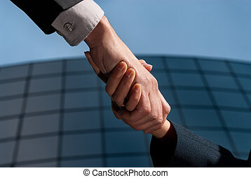 Handshake unrecognizable business man and woman on modern...