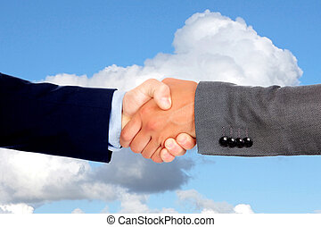 Handshake with businessmen on a blue sky
