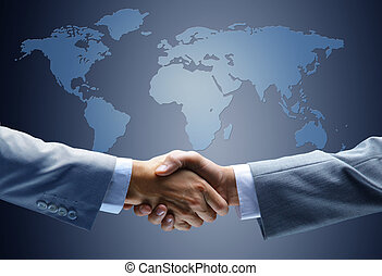 Handshake with map of the world in - Handshake with map of...
