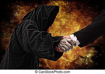 Handshake with reaper - Business handshake with reaper