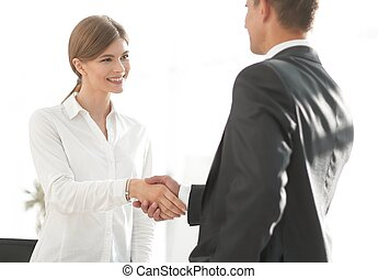 handshake young business woman with a colleague. photo with...