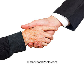 Handshake - Young businessman shaking hand with elderly...