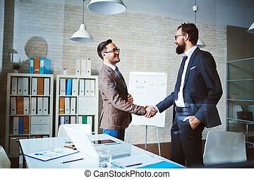 Handshaking businessmen