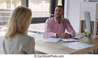 Handshaking employer and employee - Meeting in employment...