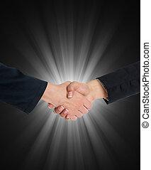 Handshaking in front of blue light
