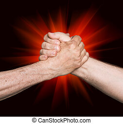 Handshaking. Man's handshake isolated on an abstract background of a red star