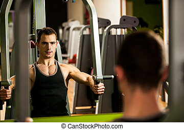 Handsom young man workout in fitness gym