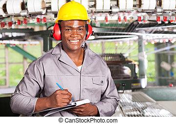 handsome african american blue collar worker portrait inside...