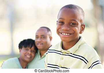 Handsome African American Boy with Parents