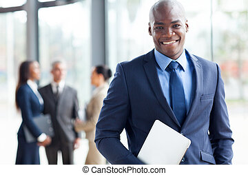 african american businessman with laptop computer in office...