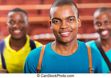 african american college boy with friends on background