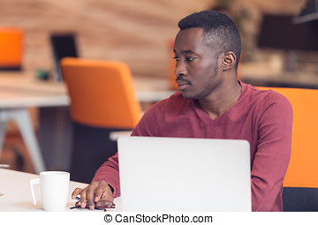 Handsome African American looking at the screen with serious face expression