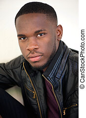 Handsome african american man posing in black leather jacket...