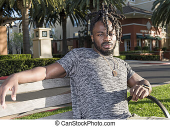 Handsome African American Man Sitting in the Park