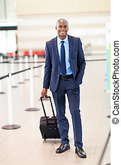 african business traveler in airport