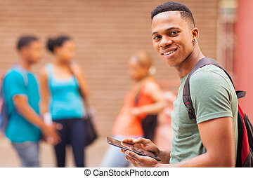 african college boy holding tablet computer