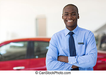 african man working at car dealership