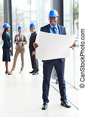 afro american architect standing in office