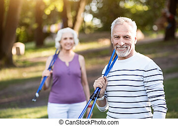 Handsome aged male smiling at the camera after nice work-out