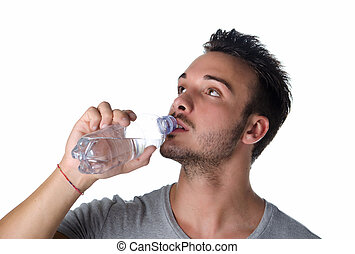 Handsome and athletic young man drinking water