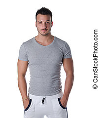 Handsome and fit young man standing on white background