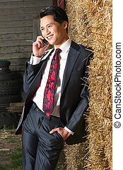 Handsome  and Happy Businessman on the Phone