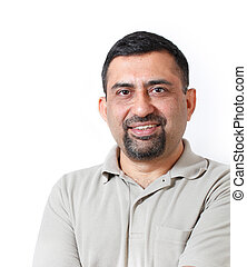 Handsome and happy middle aged mature indian adult business man looking with satisfaction and happiness. The person is wearing t-shirt and photo is shot in studio with white background
