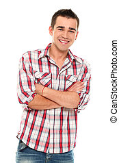 Handsome and young positive man smiling in studio